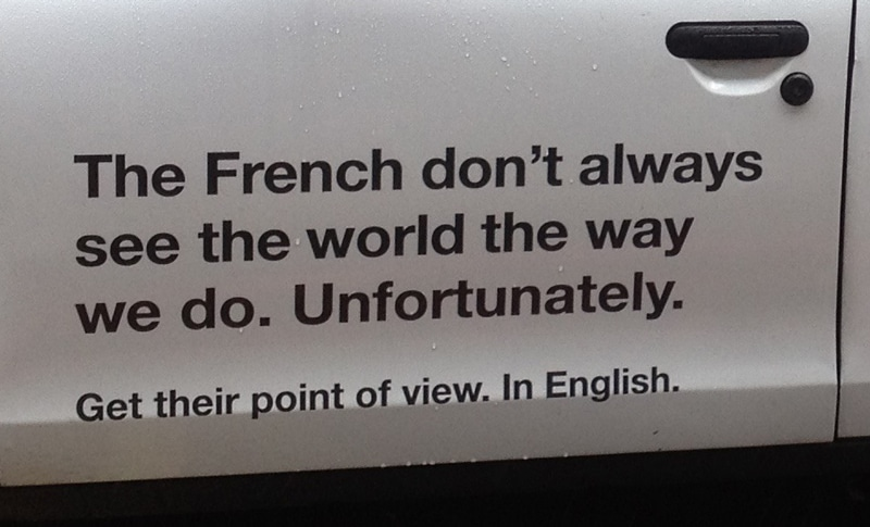 London cab with France24 ad, detail